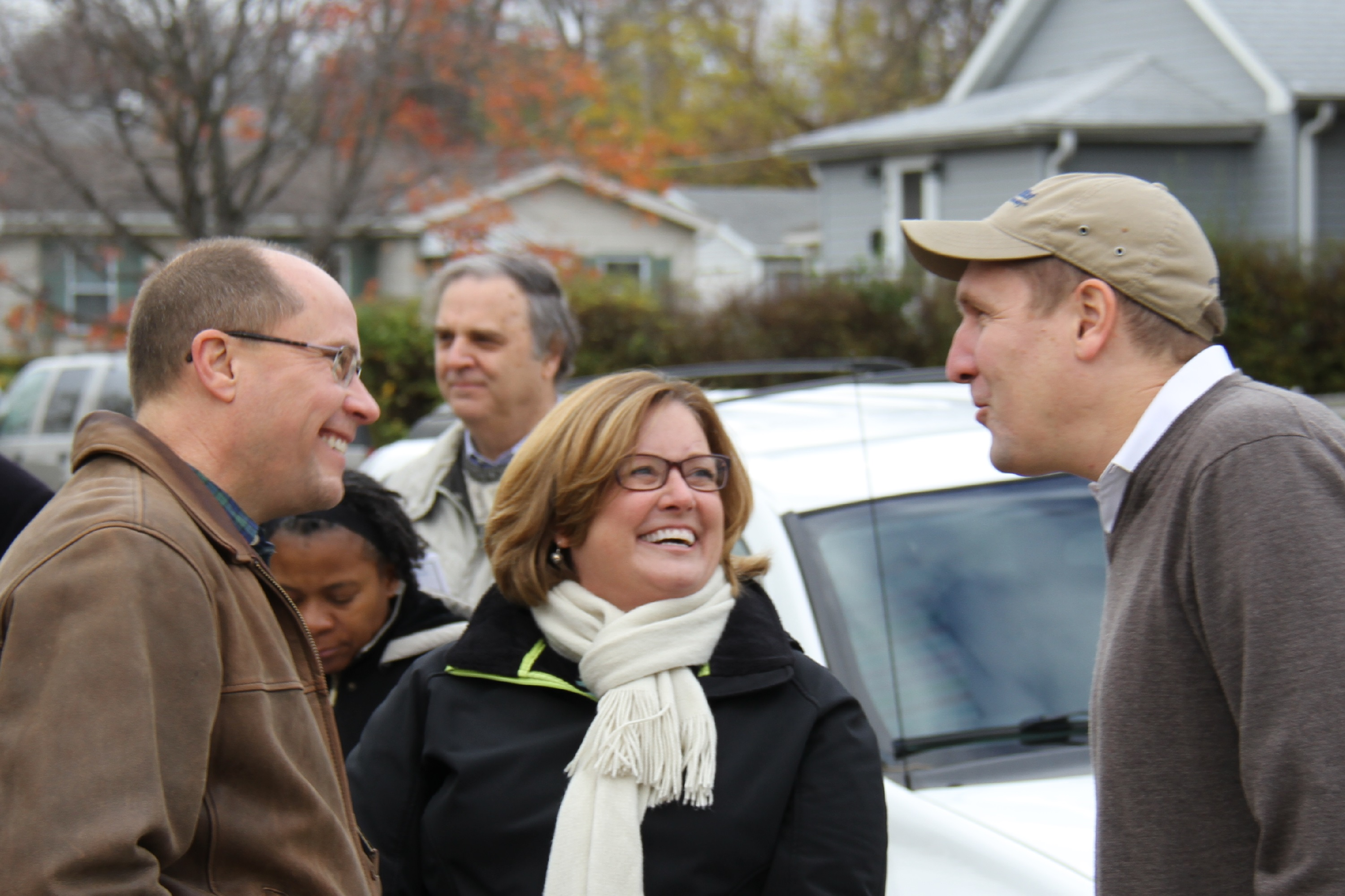 Ted & Ann Dosch (left) attend a Habitat home dedication.